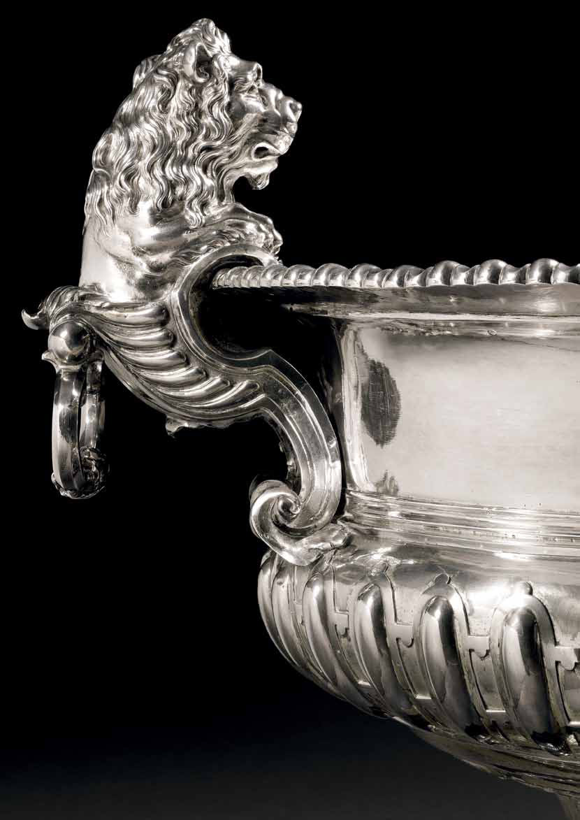 Detail showing one of the wine cooler's lion-shaped handles